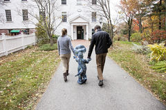 Family walking to school Royalty Free Stock Photo
