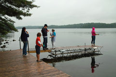 Family weekend at Ontario Canada cottage fishing. Royalty Free Stock Photos