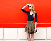 Fashion beautiful woman model in leopard skirt and sunglasses Stock Photo