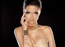Fashion Beauty Girl with Golden Jewelry. Vogue Style. Glamour La Royalty Free Stock Photo