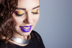 Fashion beauty shot of a beautiful young sexy girls with bright makeup and purple lips in the Studio on white background Royalty Free Stock Image