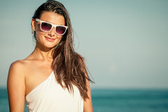 Fashion Lifestyle, Beautiful girl on the beach at the day time Royalty Free Stock Photos