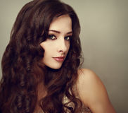 Fashion luxury female model with long curly hair. Vogue Royalty Free Stock Photography