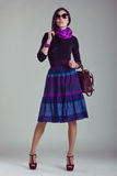 Fashion magazine shoot. Girl in fashionable clothes Royalty Free Stock Photo