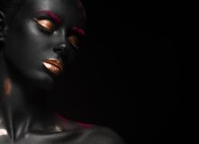 Fashion portrait of a dark-skinned girl with color Stock Images
