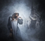 Fashion shoot of young sexy nun. Halloween concept. Stock Images