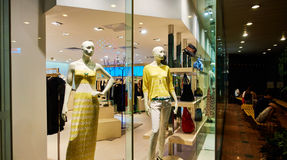 Fashion clothing store clothes shop window  Royalty Free Stock Photography