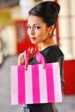 Fashion shopping girl portrait. Beautiful woman with shopping ba Stock Images