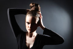 Fashion woman studio portrait with updo Royalty Free Stock Photos