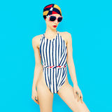Fashionable girl in vintage swimsuit. Royalty Free Stock Photos