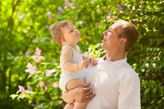 Father dad parent holding baby boy Royalty Free Stock Image