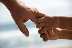 Father and son holding hands Stock Image