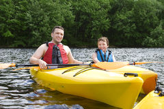 Father and son kayaking Stock Photography