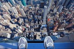 Feet on the edge of tall building Stock Photos