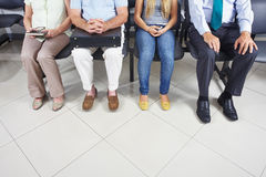 Feet of people in waiting room Royalty Free Stock Image