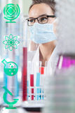 Female chemist in laboratory Stock Images