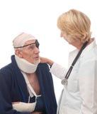 Female doctor reassuring senior patient Stock Image