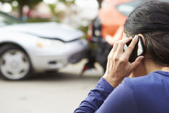 Female Driver Making Phone Call After Traffic Accident Royalty Free Stock Images