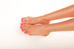 Female feet with nail varnish Stock Photography