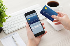 Female hands holding phone with mobile wallet for online shoppin Royalty Free Stock Image