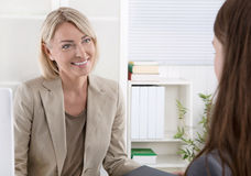 Female managing director in a job interview with a young woman. Stock Photos