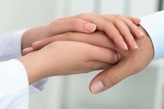Female medicine doctor reassuring her patient Stock Images