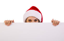 Female santa over a billboard Royalty Free Stock Images