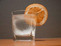 Fetta di vetro ed arancione Fotografia Stock Libera da Diritti