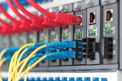 Fiber Optic cables connected to an optic ports Stock Image