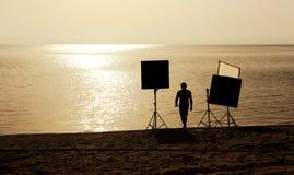 Film crew on a beach Stock Photo
