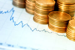 Financial chart and coins Stock Photography