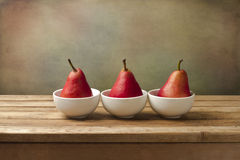 Fine art still life with red pears Royalty Free Stock Image