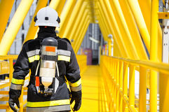 Fire fighter on oil and gas industry, successful firefighter at work Royalty Free Stock Photo