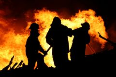 Fire fighters and huge flames Stock Images
