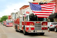 Fire Trucks with American Flags at Small Town Parade Royalty Free Stock Images