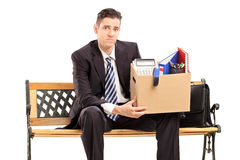 Fired businessman holding a box with his stuff Royalty Free Stock Photo
