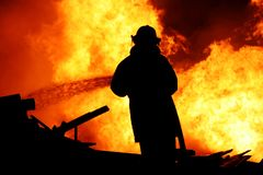 Fireman controlling a huge fire Royalty Free Stock Images