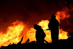 Firemen Silhouette Stock Photo