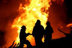 Firemen Silhouette Stock Photography