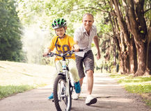First lessons bicycle riding Royalty Free Stock Photo