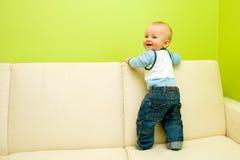 First steps on sofa Stock Photos