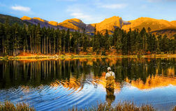 Fishing at Sunrise, in Colorado Mountains Stock Images