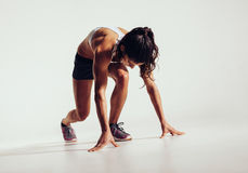 Fit female athlete ready to run Stock Photography