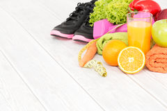 Fitness equipment and healthy nutrition. Royalty Free Stock Photos