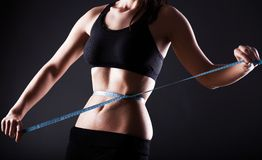Fitness woman measuring her waist, weight loss Royalty Free Stock Photo
