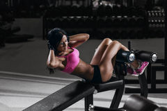 Fitness woman in sport wear with perfect sexy body in gym Stock Photography