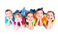 Five beautiful kids lying on the floor. Stock Images