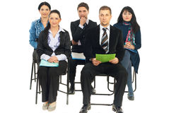 Five business people listening at conference Stock Photo