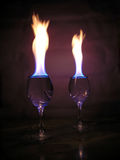 Flame above glasses. Stock Photos