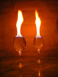Flame above glasses. Stock Photo